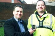 WATCHING: Cllr Paul Walmsley, left, with Neighbourhood Officer Alan Priestley, wearing one of the body cameras