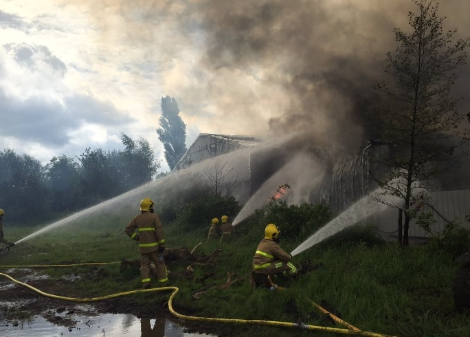 Firefighters deal with the blaze