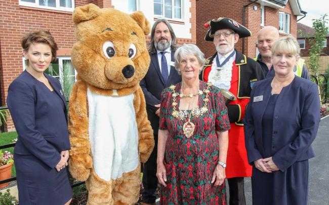 : Mayor of Chorley Cllr Doreen Dickinson and Honorary Town Crier of Clitheroe Roland Hailwood with Stewart Milne sales consultants Kate Rigby, Phil Clews, Michelle Forster and construction operative Jimmy Hilton