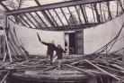 DEMOLITION: Two council workers take time off from demolishing Queens Park bandstand in 1973. First opened in front of 4,000 people in 1924, the structure had become dilapidated. It was the third bandstand to have been constructed in Queens Park. The firs