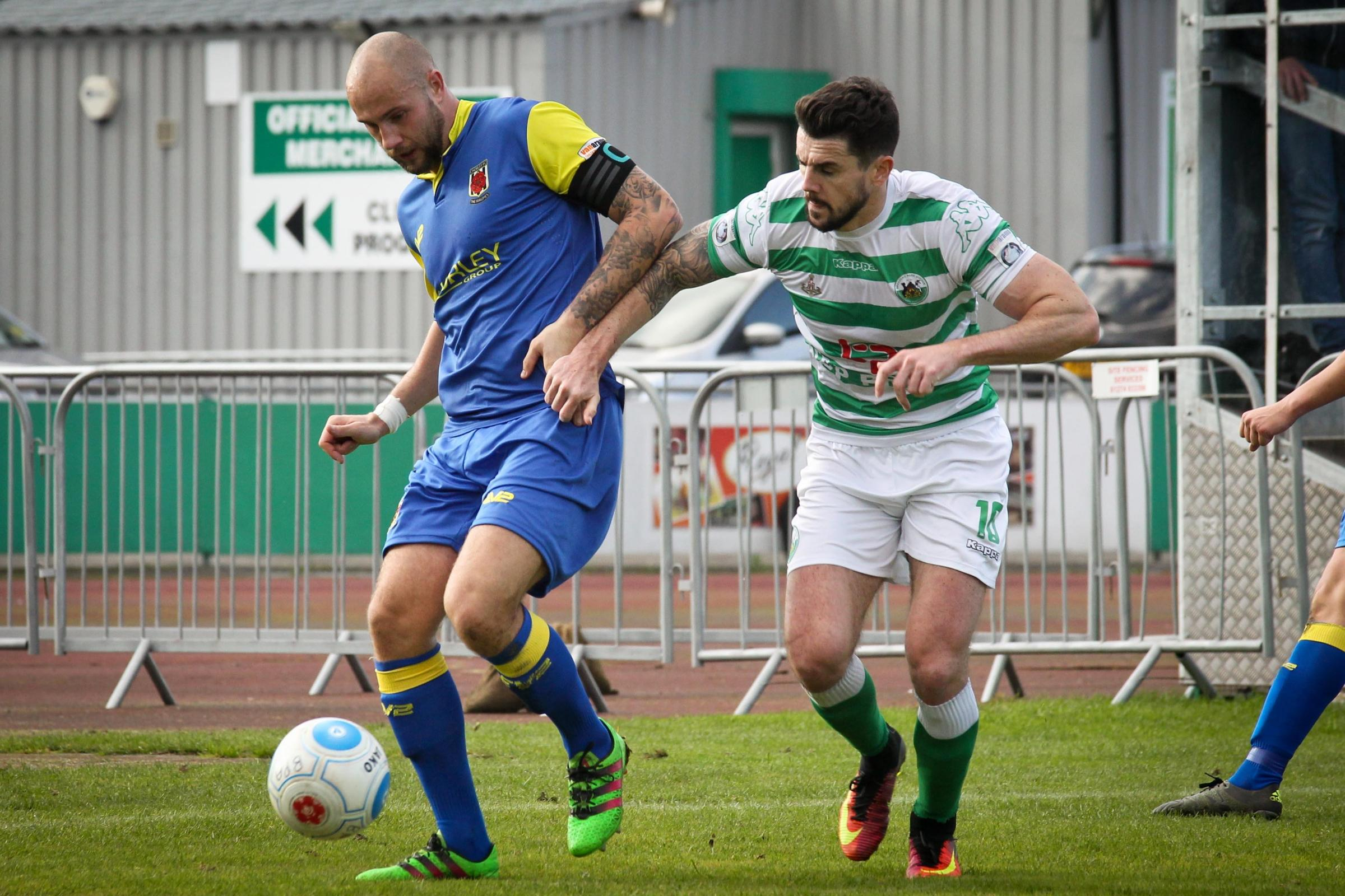 Andy Teague holds onto the ball against Bradford Park Avenue. Pics by Josh Vosper