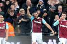 Andy Carroll, centre, scored a stunning bicycle kick against Crystal Palace
