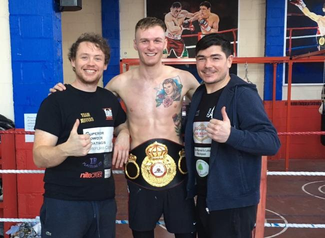 Jack Arnfield with his belt along with Dave Jennings (left)  and Michael Jennings (right)