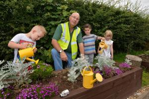 Volunteer working on a new school garden with youngsters