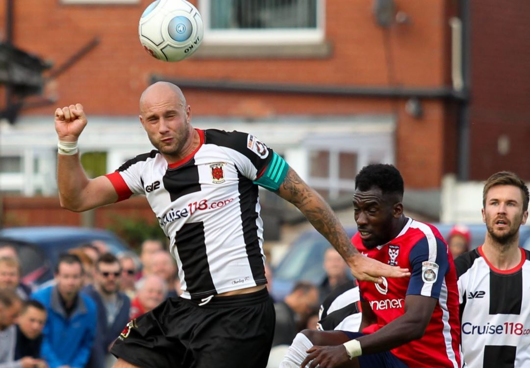 Andy Teague rises for a header for Chorley against York City. Pic by Josh Vosper