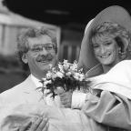 Chorley Citizen: Athlete Donna Hartley and actor Bobby Knutt leave Sheffield Registry Office following their wedding.