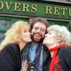 Chorley Citizen: Cliff Richard poses outside the Rovers Return with Beverley Callard (Liz), left, and Liz Dawn (Vera) as he strolls around the Coronation St set (Neil Marland/ Granada/PA)