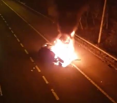 Motorway closed after car fire