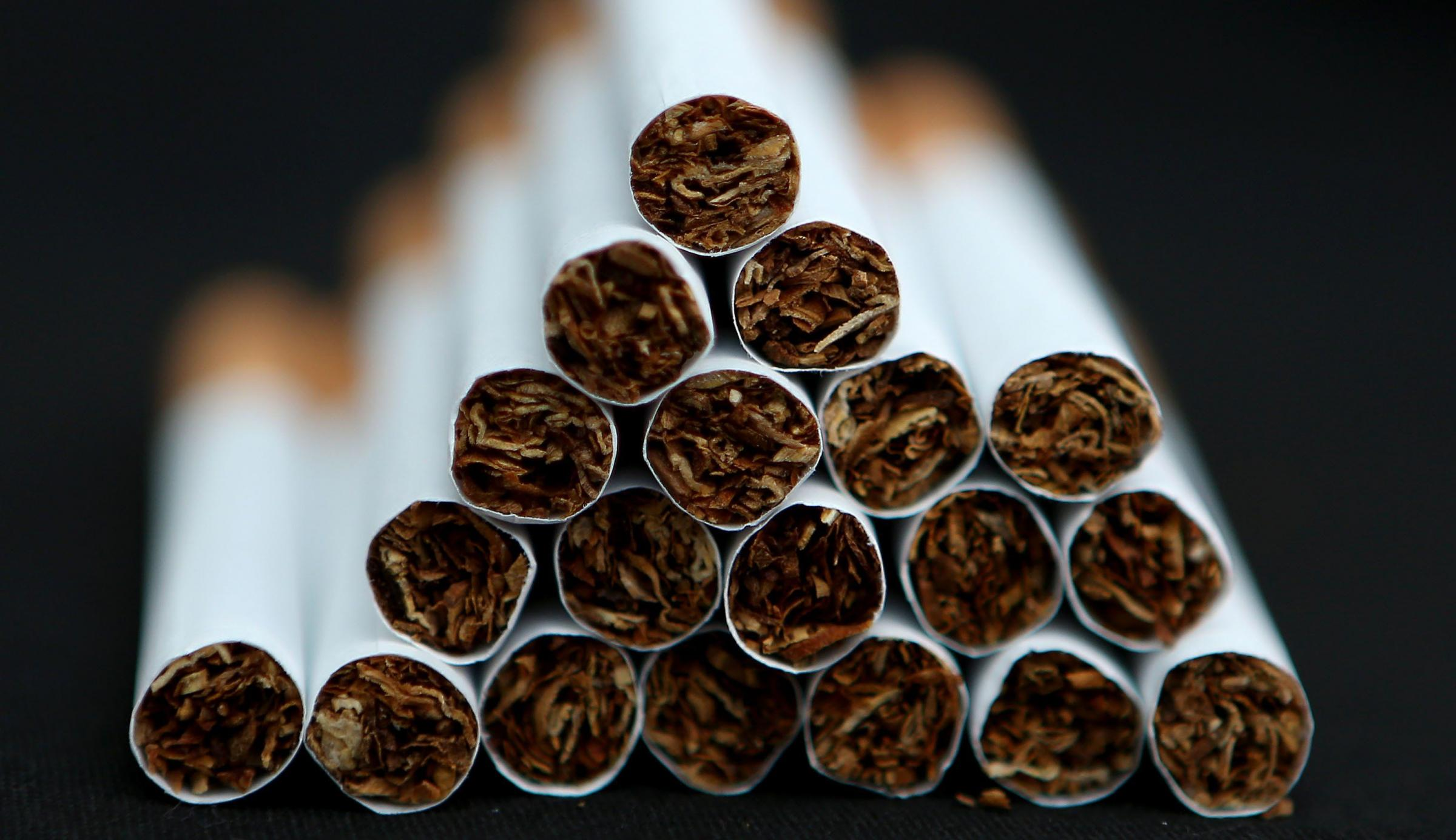 File photo dated 18/03/14 of a pile of cigarettes as a ban on displaying tobacco in small shops comes into force. PRESS ASSOCIATION Photo. Issue date: Monday April 6, 2015. The display of tobacco products, which has been illegal for large stores and super