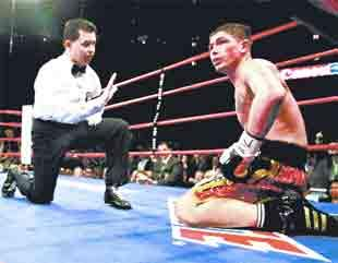 FLOORED: Referee Benji Estevez counts as Chorley's Michael Jennings takes a knee in the fifth round
