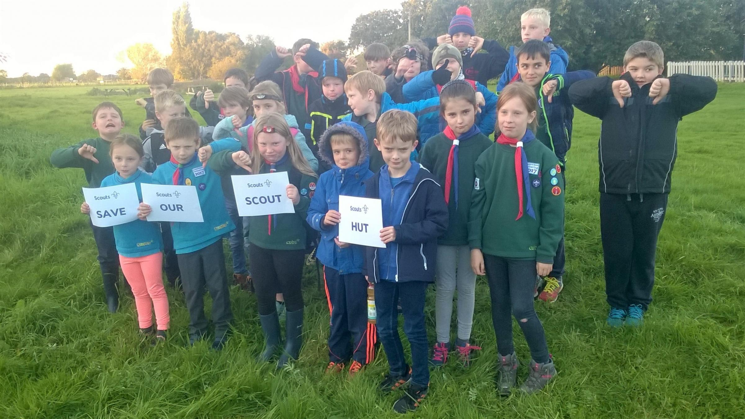 Members of the scout group campaigning against plans