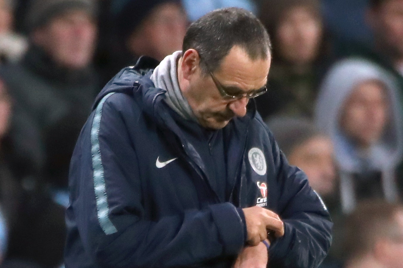 Maurizio Sarri's position as Chelsea head coach faces scrutiny following the humiliating loss at Manchester City