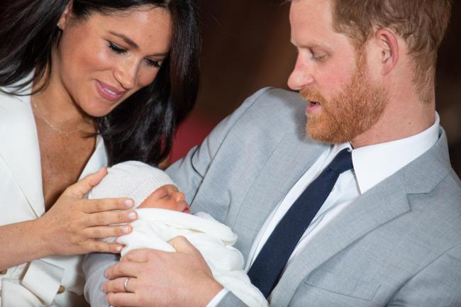 The Duke and Duchess of Sussex with their baby son, who was born on Monday morning, during a photocall in St George's Hall at Windsor Castle in Berkshire. PRESS ASSOCIATION Photo. Picture date: Wednesday May 8, 2019. See PA story ROYAL Baby. Photo cre