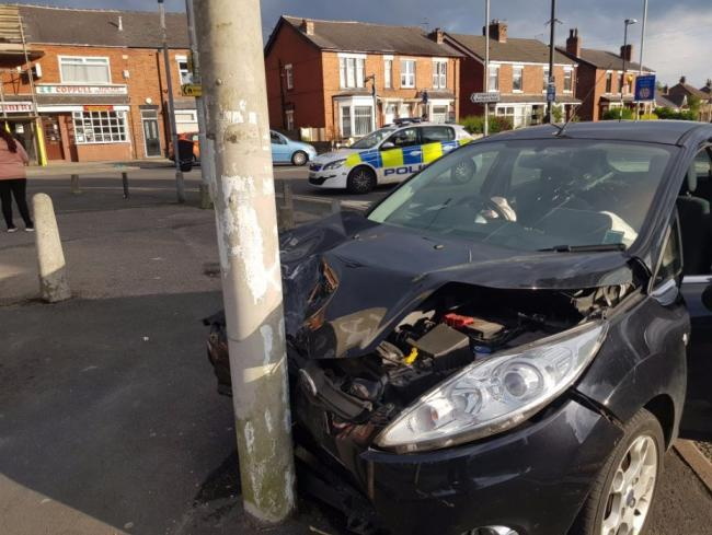 A car has crashed into a lamppost in Coppull